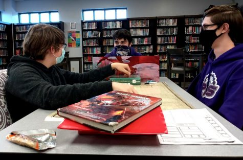 Here you can see three club members playing D&D