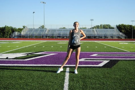 Erin Brooks stands on the athletic field
